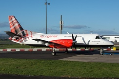 A Loganair Saab 340 freighter displaying the airline's tartan livery.