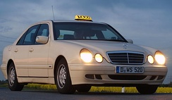 Officially licensed taxis are always ivory coloured.