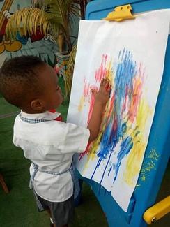 Hand painting in a Montessori school of Nigeria.