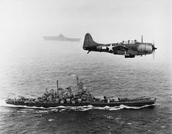U.S. Navy SBD-5 scout plane flying patrol over USS Washington and USS Lexington during the Gilbert and Marshall Islands campaign, 1943