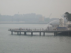 Merlion Park at the mouth of the Singapore River as seen from the Esplanade in unhealthy PSI levels.