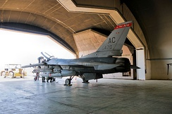 Members of the 332d Expeditionary Aircraft Maintenance Squadron (EAMXS), place an F-16C+ Fighting Falcon from the 119th Expeditionary Fighter Squadron, New Jersey ANG back in a hardened aircraft shelter (HAS) at Joint Base Balad, Iraq on 4 May 2010