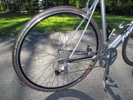Bicycle rear wheel showing front and rear derailleurs, and rear cogset