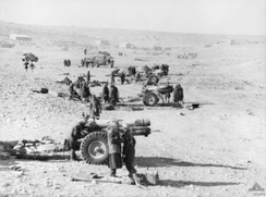 British 6 inch howitzers in action at Tobruk during Operation Compass, 23 January 1941.