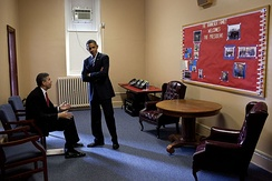 Duncan talking to Barack Obama before Obama delivered a speech at a Washington, D.C.-area high school in September 2011.