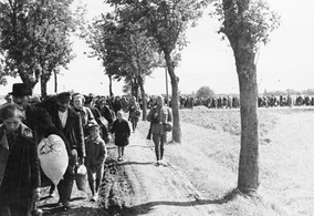 Ethnic cleansing of western Poland, with Poles led to the trains under German army escort, 1939.