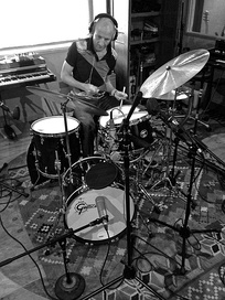 "Drummer Clive Deamer has joined Radiohead on tour since 2012. He also performed on the ""Staircase / The Daily Mail"" single and A Moon Shaped Pool."