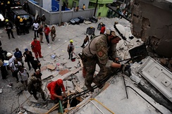 A PJ from the 23rd STS searching for survivors of the 2010 Haiti earthquake in Port-au-Prince