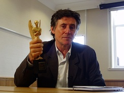 Gabriel Byrne holding his Herald Angel