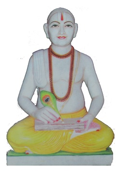 Tulsidas composes one of his works. Statue at Sant Tulsidas Municipal Inter College, Soron, Kasganj, India.