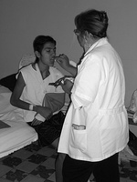 A hospitalized man receives communion from a chaplain, Guadalajara, Mexico