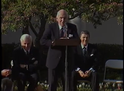 John McCloy accepts an award for an honorary citizen of Berlin as President von Weizsacker and President Ronald Reagan look on.