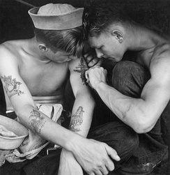 Sailor being tattooed by fellow sailor aboard USS New Jersey in 1944