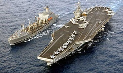 American aircraft carrier USS Harry S. Truman and a replenishment ship
