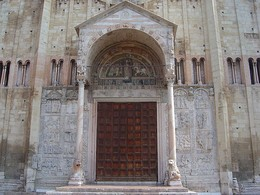 San Zeno, Verona, has a porch typical of Italy. The square-topped doorway is surmounted by a mosaic. To either side are marble reliefs showing the Fall of Man and the Life of Christ