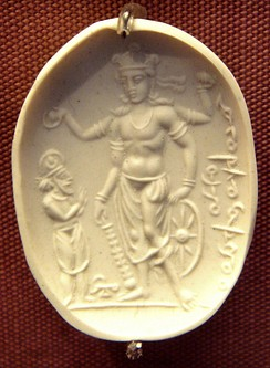 "Cast of sardonyx seal representing Vishnu blessing a worshiper 4th-6th century CE. The inscription in cursive Bactrian reads: ""Mihira, Vishnu and Shiva"".[11]"