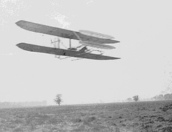 Wilbur flying almost four circles of Huffman Prairie, about ​2 3⁄4 miles in 5 minutes 4 seconds; flight #82, November 9, 1904.