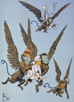 """The monkeys caught Dorothy in their arms and flew away with her""—illustration by W. W. Denslow in  The Wonderful Wizard of Oz (1900)"