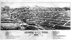 Bird's eye view of dwellings, commercial and civic buildings between the Arkansas River and mountains in This drawing of Canon City, Colorado, 1882.