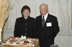 Borlaug with United States Secretary of Agriculture Ann M. Veneman near the birthday cake prepared for his 90th birthday