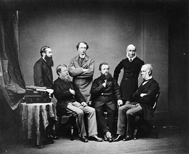 The British high commissioners to the Treaty of Washington of 1871. Standing: L. to R.: Lord Tenterden, Sir John A. Macdonald, Mountague Bernard. Seated: L. to R.: Sir Stafford Northcote, Earl de Grey & Ripon, Sir Edward Thornton.
