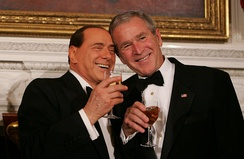 Silvio Berlusconi with United States President George W. Bush during a state dinner in honor of Berlusconi's visit to the White House.