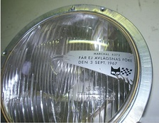 "Headlamp sold in Sweden not long before Dagen H changeover from left to right hand traffic. Opaque decal blocks the lens portion for low beam upkick to the right, and bears warning: ""Not to be removed before 3 September 1967""."