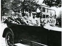 "Casey (front passenger seat) in ""Casey Day"" parade, July 1915"