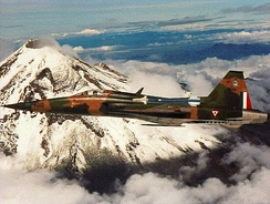 Mexican Air Force F-5 Tiger flying near the Popocatepetl volcano