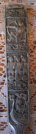 Detail on a pewter fork handle from Norway, showing three scenes: King Olaf II of Norway, his men, and a Viking ship