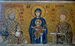 12th century mosaic from the upper gallery of the Hagia Sophia, Constantinople. Emperor John II (1118–1143) is shown on the left, with the Virgin Mary and infant Jesus in the centre, and John's consort Empress Irene on the right.