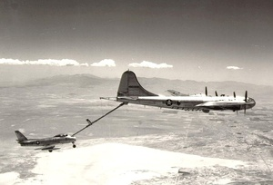 A KB-29M delivers fuel to an F-86A Sabre over Rogers Dry Lake. Note that the fighter is flying nose-high in order to match its speed to the slower tanker; even so, it had to lower its landing gear for additional drag.