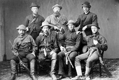 Marsh (back row and center), surrounded by armed assistants for his 1872 expedition. Marsh spent little time in the field himself, generally delegating these tasks to his agents.[18]