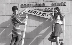 Students changing the institution sign after being granted university status by the Oregon State Board of Higher Education, 1969