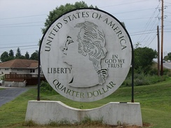 The oversized quarter at the entrance to Down River Golf Course