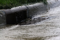 Urban runoff flowing into a storm drain