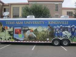 TAMU-Kingsville touring bus parked in front of the Lewis Education and Academic Center at Laredo Community College on April 30, 2012
