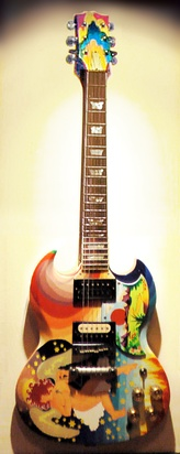 "Clapton's The Fool guitar (replica shown), with its bright artwork and famous ""woman tone"", was symbolic of the 1960s psychedelic rock era."