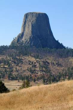 Devils Tower, an igneous intrusion exposed when the surrounding softer rock eroded away
