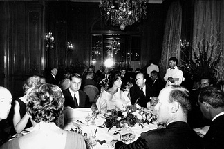 A dinner for fashion designer Charles Jourdan at the trendy Plaza Athénée hotel in Paris, 1962.