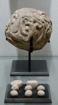 Globular envelope with a cluster of accountancy tokens, Uruk period, from Susa. Louvre Museum