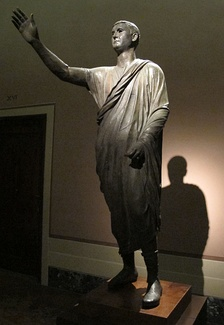 The Orator, c. 100 BC, an Etrusco-Roman bronze statue depicting Aule Metele (Latin: Aulus Metellus), an Etruscan man wearing a Roman toga while engaged in rhetoric; the statue features an inscription in the Etruscan alphabet