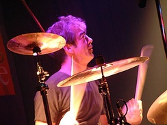 Bill Berry behind a drum kit