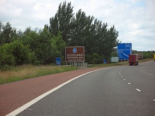 A sign marking entry to Scotland located on the M6 motorway crossing the border of Cumbria.