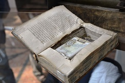 Cigarettes concealed by a hidden compartment cut into a book.