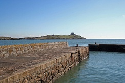 Coliemore Harbour and in the distance Dalkey Island with Martello Tower