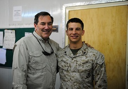 Donnelly with service member of the United States Marine Corps