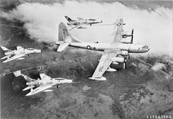 Boeing B-KB50D Superfortress 48-123 of Air Proving Ground Command carrying out first triple-point refuelling operation with three North American F-100C Super Sabres (54-1825, 53-1774, 54-1848) of the 451st Fighter Day Squadron (322d FDG), 1956