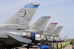 Three F-16CJ Block 50 Fighting Falcons from Spangdahlem Air Base after arriving to join the 148th Fighter Wing at Dulus ANGB during 2010. In front is an F-16C Block 25C from the 148th FW that was replaced.
