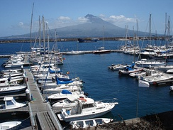 The port of Horta, on Faial Island is famed worldwide as a trans-Atlantic stop for yachts and sailors.[63]